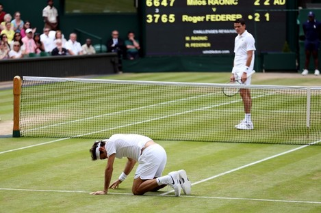 Down and out: Federer took a tumble in the fifth set.