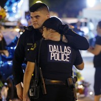 Obama heads for Dallas as protests hit US streets following brutal murder of five policemen