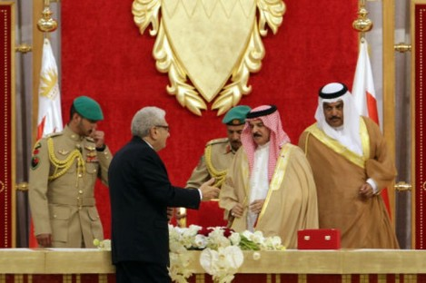 Investigator Cherif Bassiouni, in black, presents his report to Bahrain's king today.