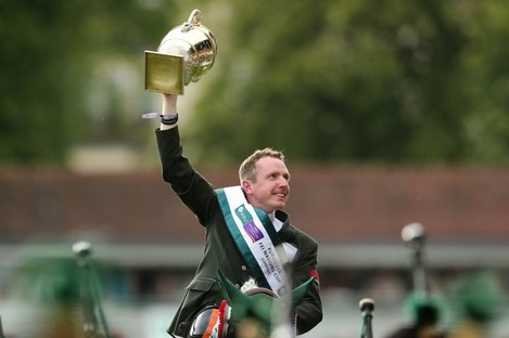 Greg Patrick Broderick celebrates with The Furusiyya FEI Nations Cup in 2015.