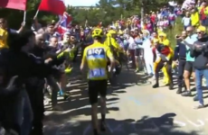 Bizarre scenes as Chris Froome runs up Mont Ventoux after damaging bike in crash