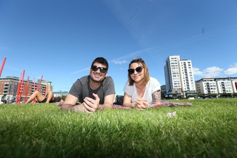 Folipe Ferreira and Daphine Barbosa while enjoying the sunny weather at The Docklands Area in Dublin