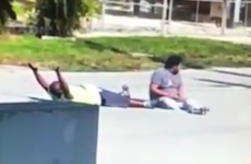 Police shoot unarmed man as he lies on the ground with his hands up
