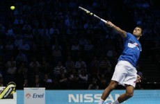 Tsonga stuns Nadal as Federer marches on