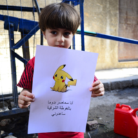Syrian children pose with drawings of Pokemon, pleading to be saved from violence
