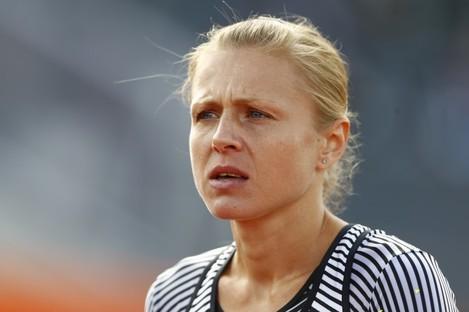 Russian doping whistleblower Yuliya Stepanova who runs under a neutral flag prepares a women's 800m heat during the European Athletics Championships in Amsterdam.