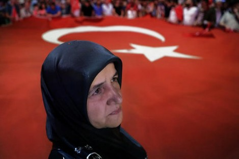 A woman takes part in an anti-coup rally at Taksim square in Istanbul yesterday.