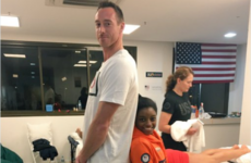 This photo showing the height difference between two Olympic athletes is mind blowing