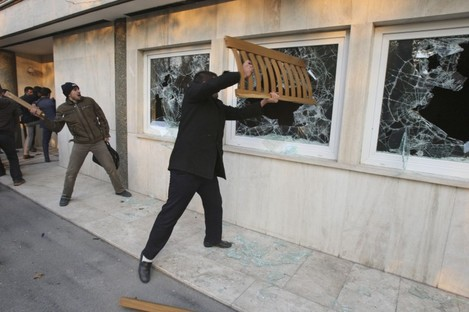 Iranian protesters break the windows of a British Embassy building, in Tehran, Iran, Tuesday, Nov. 29, 2011.