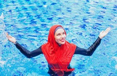 Mayor of town on French island bans burkinis after beach brawl