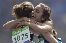 Two runners put medal hopes on hold to help each other finish race after ugly fall