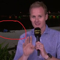 A couple looked like they were having sex behind the BBC's live Olympics coverage
