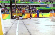 41-year-old runner slips on Olympic marathon finish line...but saves himself by doing push-ups