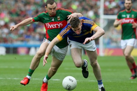 Keith Higgins in action with Jimmy Feehan.
