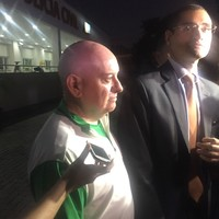 OCI'S Kevin Kilty and Stephen Martin wear Team Ireland kits as they leave Rio police station