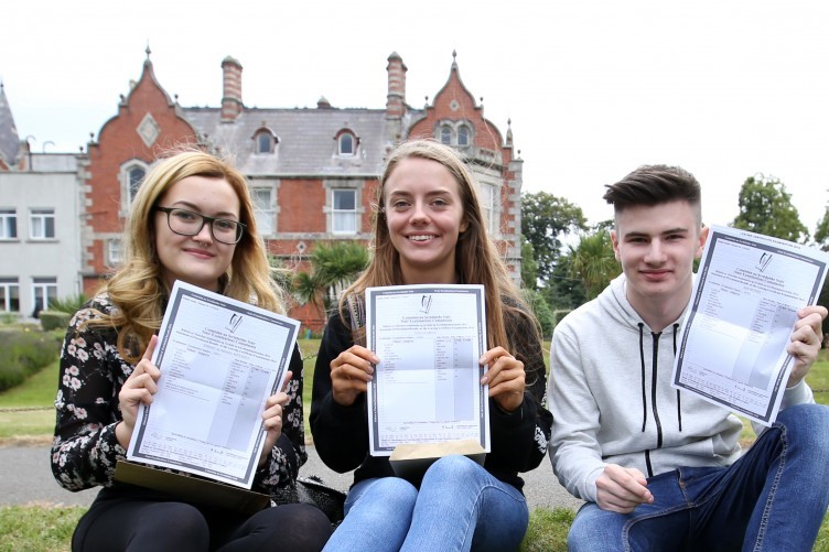 Spring Mitchell, Paula Grina and Ian Bethel in Mount Temple Comprehensive School in Dublin with their Leaving Cert results.