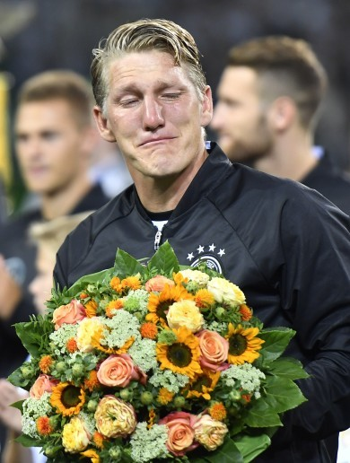 Tearful Schweinsteiger bows out in Germany's win over Finland