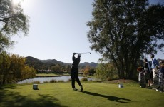 Johnson wrests lead from Woods in California