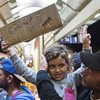 Merkel's refugee policy under pressure after poll defeat to anti-migrant party