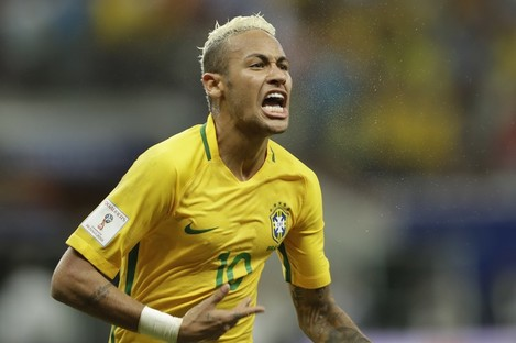 Brazil's Neymar celebrates scoring his side's second goal against Colombia during a 2018 World Cup qualifying soccer match in Manaus.
