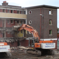 Watch: Former residents look on as council flats torn down