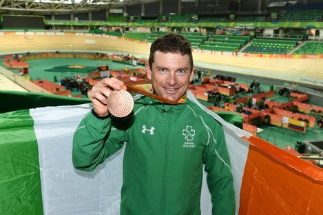 Clifford celebrates with his medal.