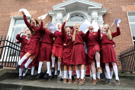Students from Loreto College jump around after receiving their results in 2013.
