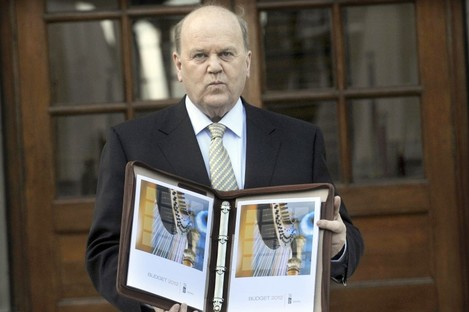 Michael Noonan with the Budget before presenting it to the Dáil