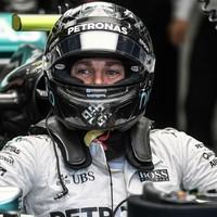 Nico Rosberg takes Singapore pole with Sebastian Vettel to start last