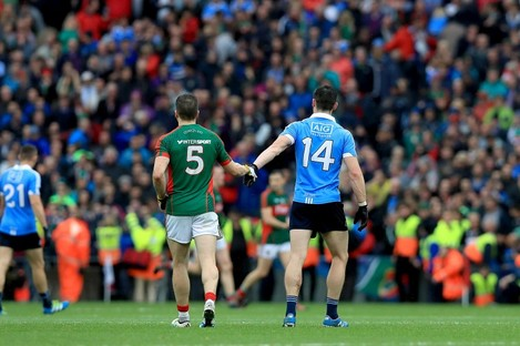 Mayo's Lee Keegan and Dublin's Diarmuid Connolly shake hands after the game.