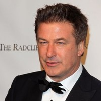 Alec Baldwin forced from flight over phone game