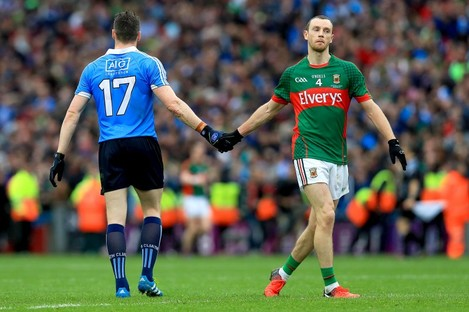 Paddy Andrews and Keith Higgins shake hands after last Sunday's game.