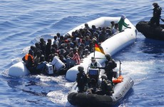 42 people drown after boat carrying 450 migrants capsizes at sea