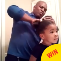 This video of a little girl showing her dad how to do her hair is melting hearts on Facebook