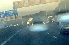 An articulated truck is blocking part of the M50 in Dublin