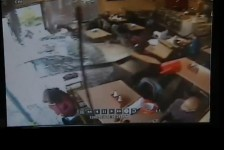 CCTV footage: Car crashes through front of California diner