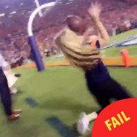 This poor woman got a football straight to the face on live TV