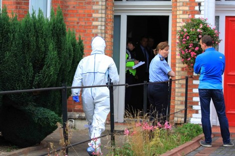 Gardaí and forensic examiners outside the house in Dublin today.