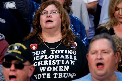 Trump supporters cheer at a rally for him in Pennsylvania yesterday
