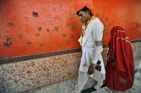 An under-age newly-married couple who refused to be identified walk together after a mass marriage at Chachoda village in Rajgarh town, India. Even though child marriages are illegal in India, they are still held particularly in small poverty stricken villages.