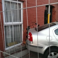 'Substantial damage' caused as car crashes into front wall of house