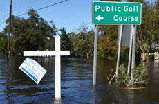 Man shot dead in search for flood victims, as Hurricane Matthew's death toll mounts