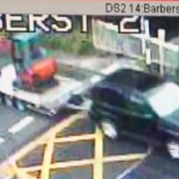 CCTV footage catches a 4X4 pulling down the gates at a level crossing