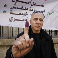 Syrian troops and army defectors clash as elections underway