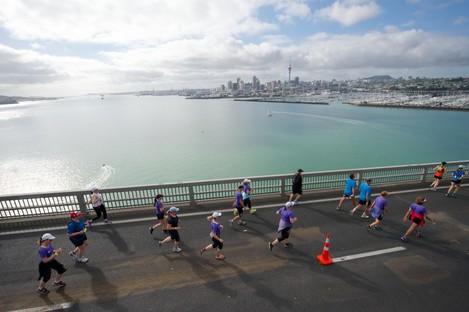 Runners cross the harbour bridge in the 2014 Auckland Marathon.