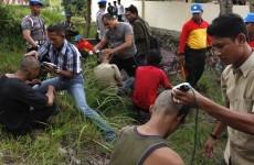 Hard-line Indonesian police shave punks' mohawks