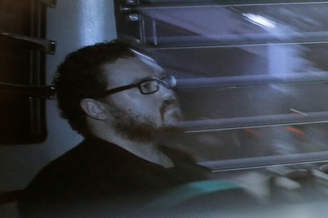 Jutting sits in a prison bus as he arrives at a court in Hong Kong.  (File, 2014)
