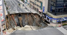 Japanese city street swallowed by giant sinkhole