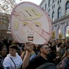 Protesters light fires in streets and block traffic in response to Trump's shock election
