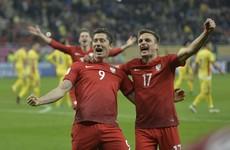Robert Lewandowski scored twice even after narrowly escaping injury in firework incident